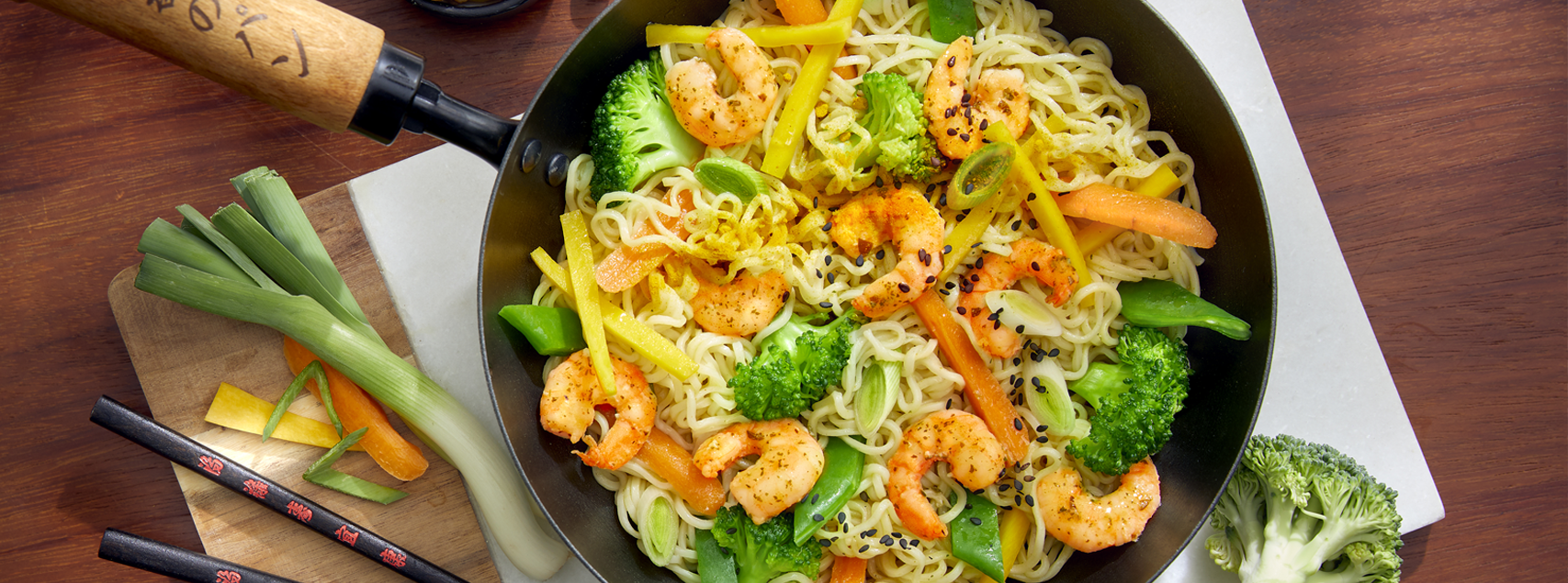 Pan of Chinese noodles with marinated prawns