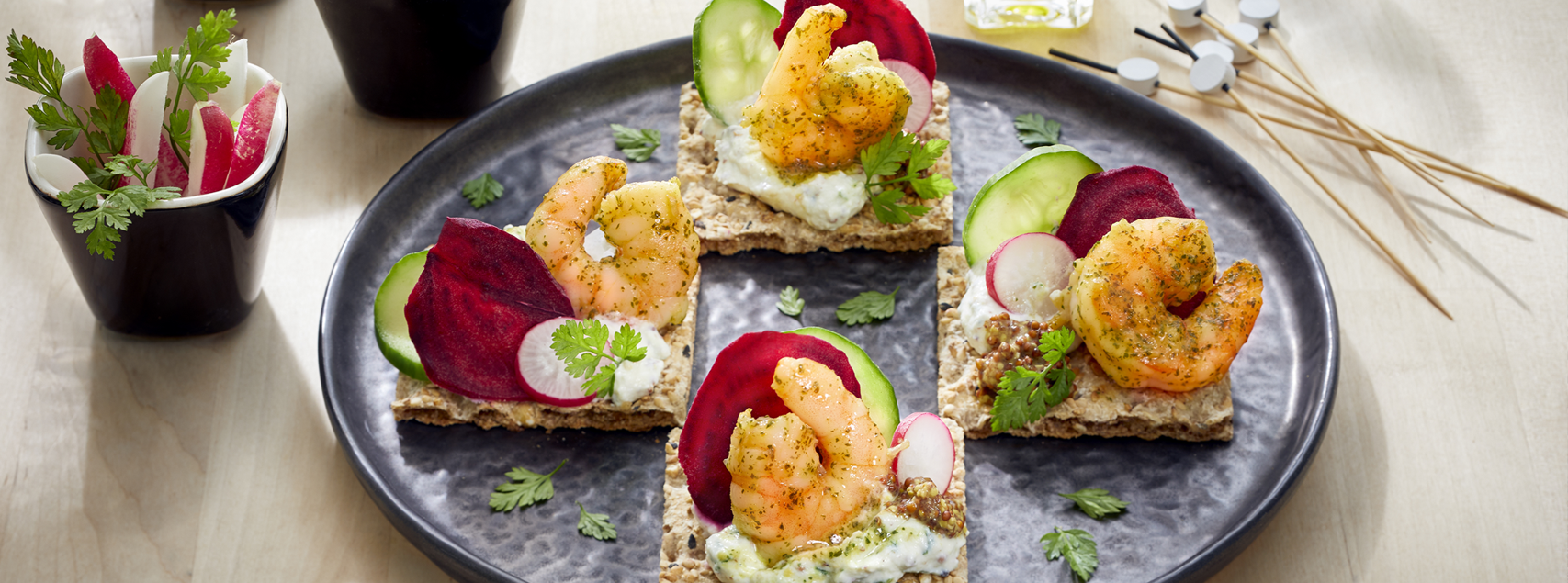Canapés for aperitifs with organic marinated shrimps and crudities